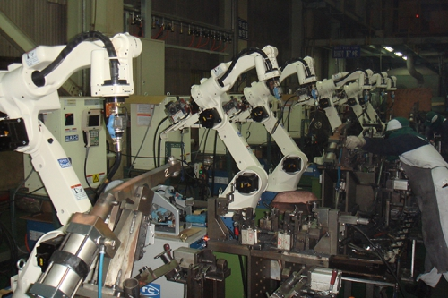 OTC ROBOT 機車車架生產線